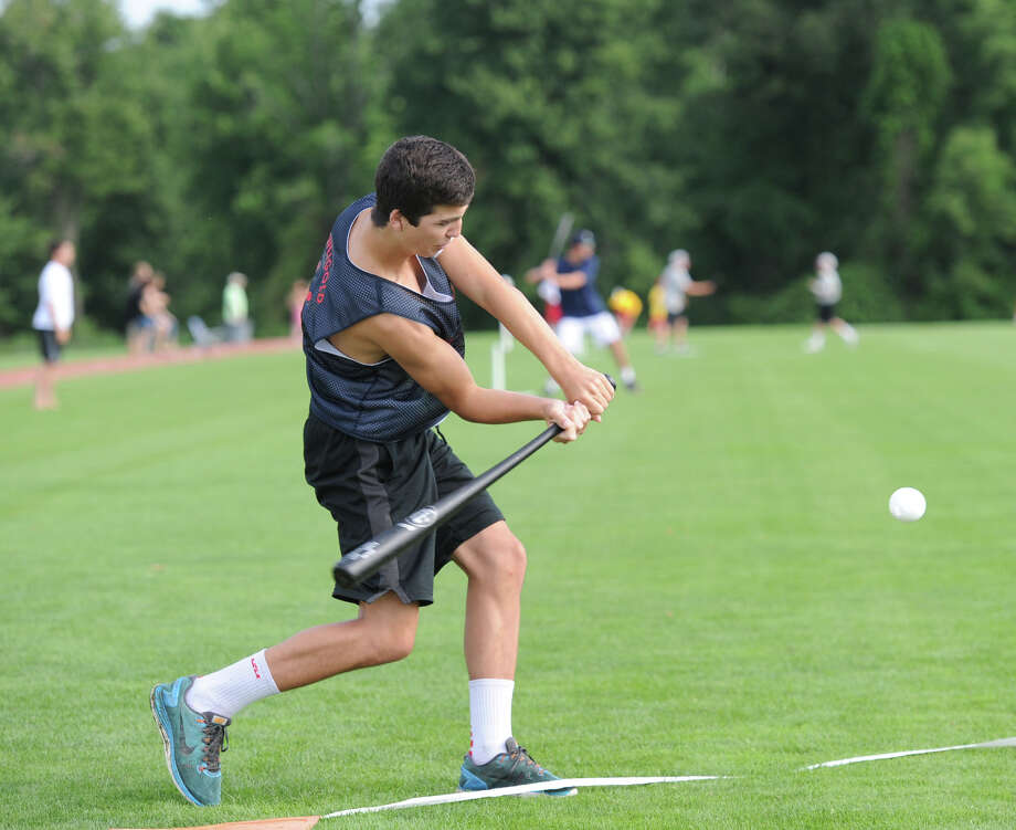 A player swings during the annual Greenwich Wiffle Ball Tournament at the Greenwich Polo Club, Conyers Farm, Greenwich, Conn., Saturday, July 26, 2014. This year's tournament was rained out Saturday morning, and rescheduled for July 25. Photo: Bob Luckey / Bob Luckey / Greenwich Time