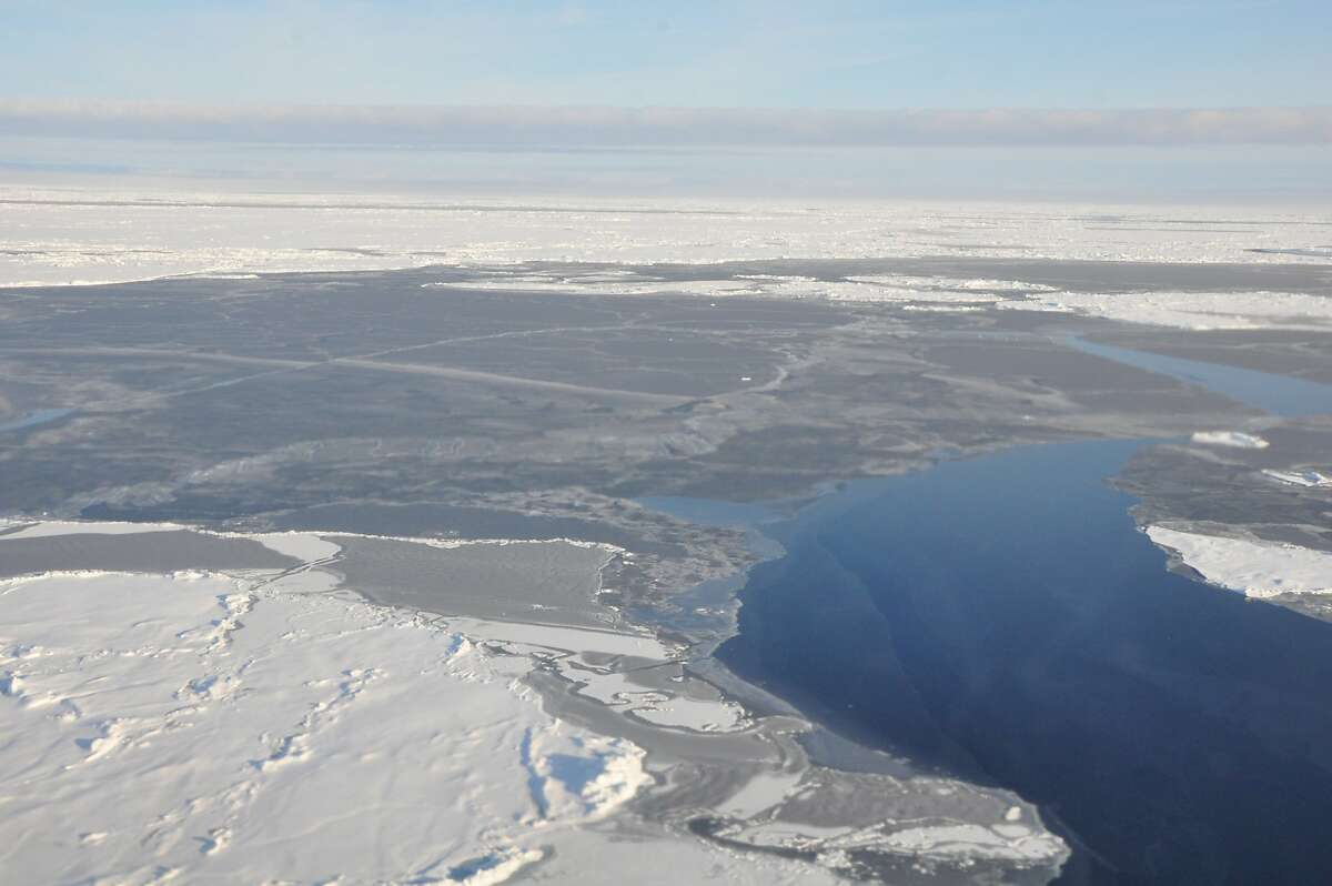 This 2014 photo provided by NOAA shows the Arctic ice coverage.