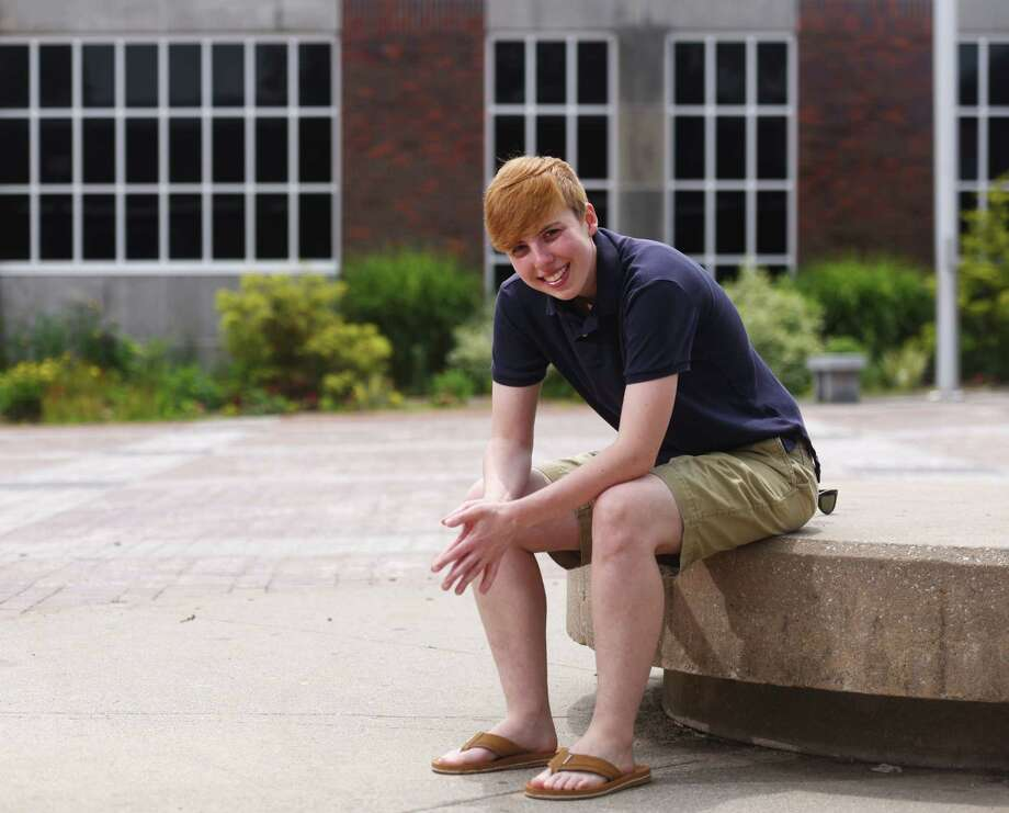 Transgender GHS graduate Evan Connors poses outside Greenwich High School in Greenwich, Conn. Thursday, July 2, 2015. Photo: Tyler Sizemore / Hearst Connecticut Media / Greenwich Time