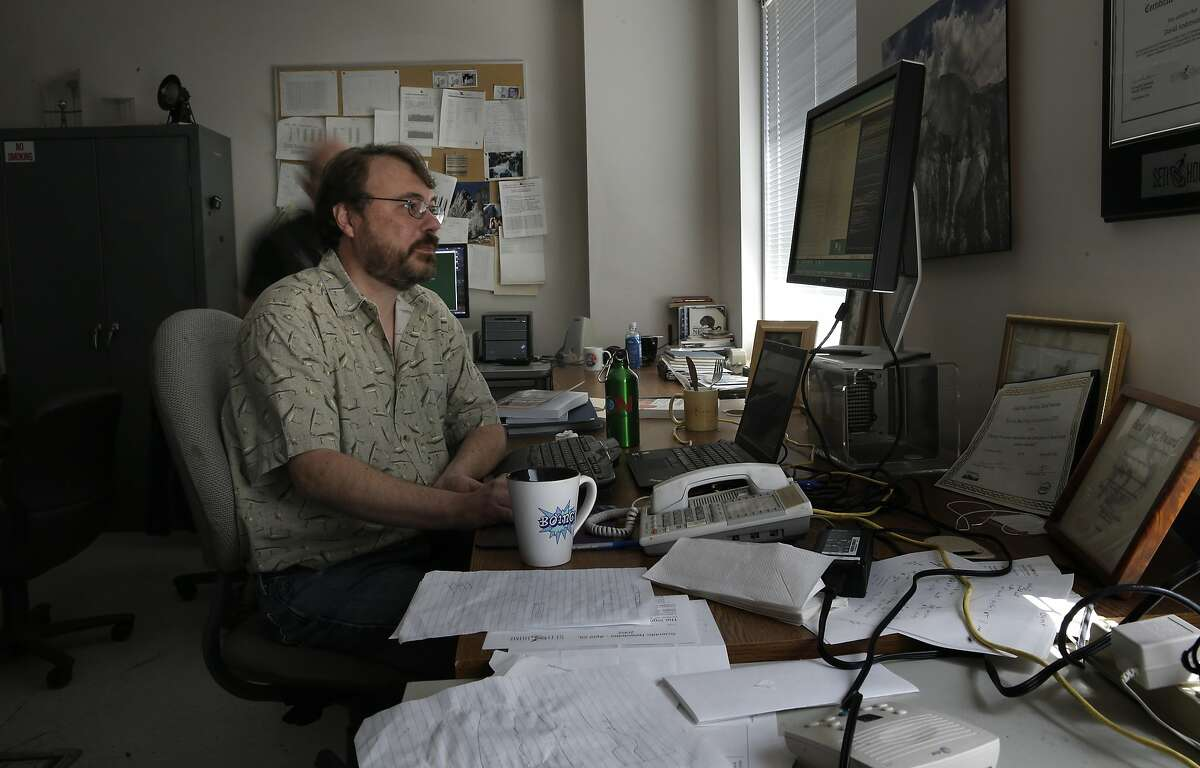 Eric Korpela the director of SETI (the Search for Extraterrestrial Intelligence) at Home at the Berkeley SETI research center at UC Berkeley, works at his desk area, as seen on Fri. July 17, 2015, in Berkley, Calif.