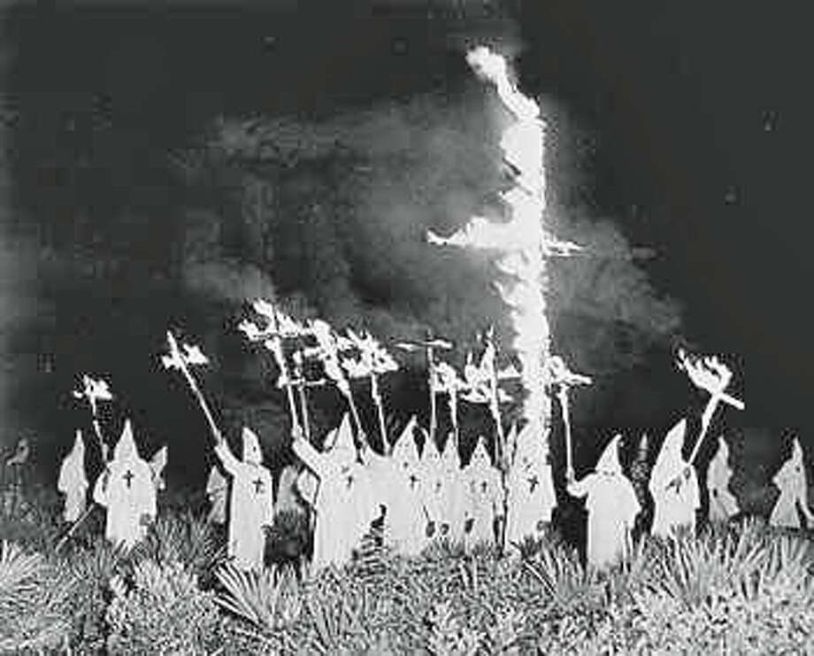 The Ku Klux Klan burns a cross in Greenwich in 1924. Photo: Contributed / Contributed Photo / Greenwich Time Contributed