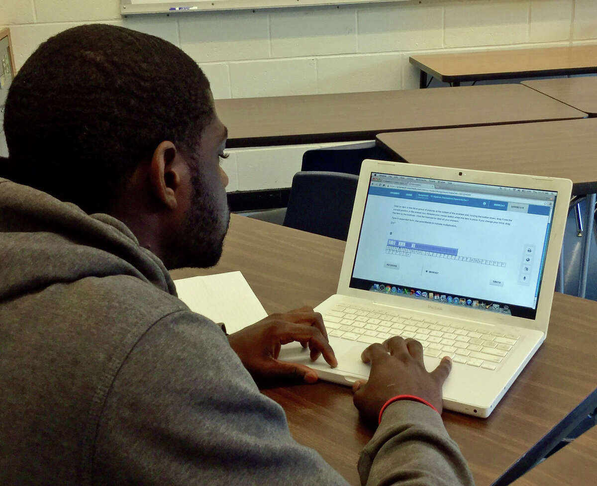 Greenwich High School rising senior Zeik Dume works on his Algebra II course in Odysseyware Thursday at Central Middle School.