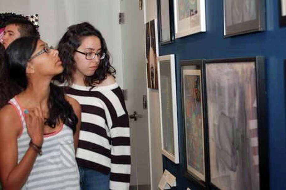 Students review the art selected for the 2014 iCreate exhibition at the Bruce Museum, 1 Museum Drive. The 2015 iCreate exhibit will run through June 26 featuring the work of 40 of the area's high school students. Photo: Contributed Photo /