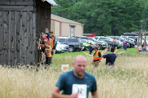Participants compete in the Maple Ski Ridge5k Mud Run on Saturday July 18, 2015 in Schenectady, N.Y. (Michael P. Farrell/Times Union) Photo: Michael P. Farrell / 00032662A