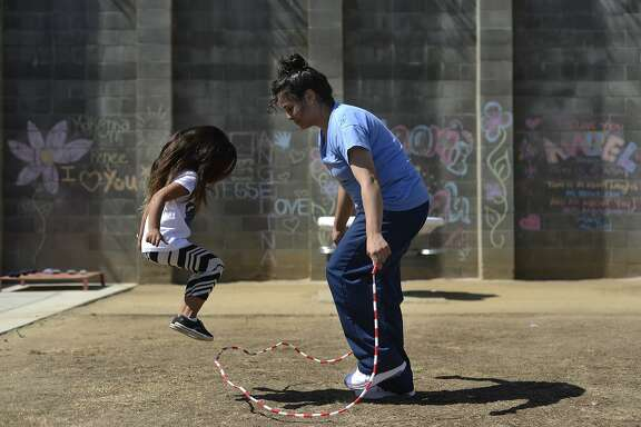 Xochilt Tobon (right) jumps rope with her daughter Nariah Henderson (left) at Folsom Women's Facility in Folsom, California, on Saturday, July 18, 2015.