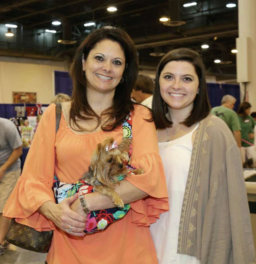 Dog lovers pose for a photo at the 38th Annual Houston World Series of Dog Shows at NRG Center Saturday, July 18, 2015, in Houston. Photo: Jon Shapley, Houston Chronicle / © 2015 Houston Chronicle