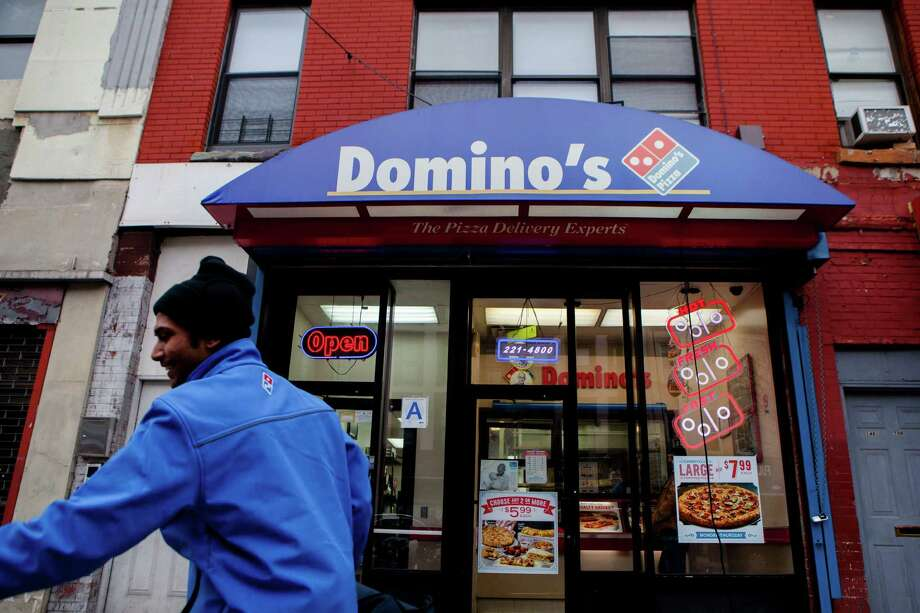 Domino's Pizza, like other fast-food chains, object to the proposed FDA rule on calorie counts, saying many customers order online and don't come into the stores and look at menus. Consumer advocates said the delay on implementing the rule was a setback for public health. Photo: SAM HODGSON, STR / NYTNS