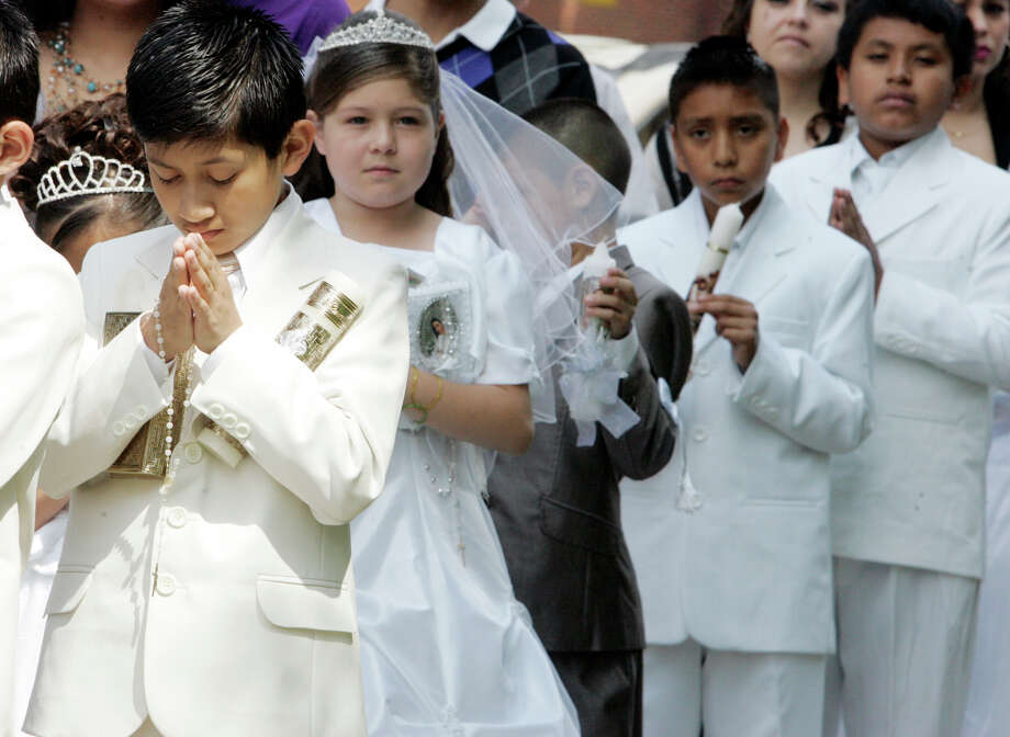 First Communicants line up to proccess into St Joseph Catholic Church for their First Communion Mass Saturday May 12, 2012 in LaPorte, Ind. (AP Photo/The LaPorte Herald-Argus, Bob Wellinski) Photo: Bob Wellinski, MBR / AP / LaPorte Herald Argus
