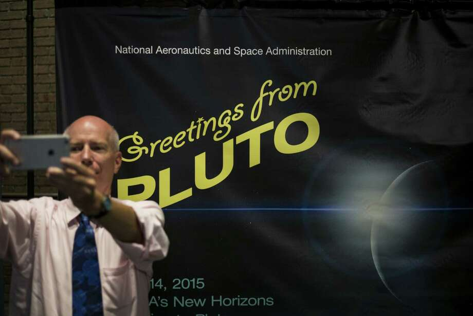 A man takes a selfie at the Johns Hopkins University Applied Physics Laboratory in Laurel, Md., on Tuesday, the day New Horizons did its Pluto flyby. Photo: Brendan Smialowski /Getty Images / AFP