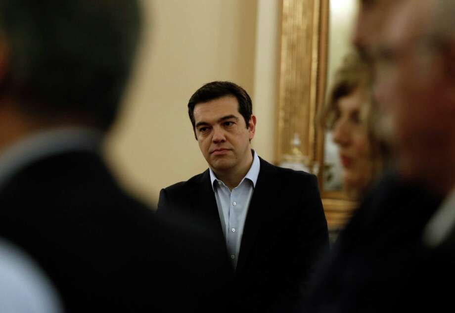 Greece's Prime Minister Alexis Tsipras attends the swearing in ceremony of his new ministers at the Presidential Palace in Athens, Saturday, July 18, 2015. Tsipras reshuffled his Cabinet on Friday following a rebellion within his party over a parliamentary vote to approve the measures demanded for the bailout talks to start. Greek parliament approved creditor's demand for austerity measures. (AP Photo/Thanassis Stavrakis) Photo: Thanassis Stavrakis, STF / AP