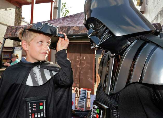Eight-year-old Ryan Antalek of Valatie lifts the mask of his own Darth Vader costume to get a good look at a real Darth Vader during Star Wars night at Joe Bruno Stadium before Saturday's game between Aberdeen IronBirds at Tri-City ValleyCats July 18, 2015 in Troy, NY.  (John Carl D'Annibale / Times Union) Photo: John Carl D'Annibale / 00032630A