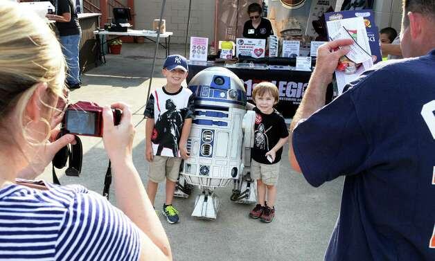 Cousins David Kramek, 5, left, and Jacob Carpenter, 4, of Stillwater pose with R2D2 during Star Wars night at Joe Bruno Stadium before Saturday's game between Aberdeen IronBirds at Tri-City ValleyCats July 18, 2015 in Troy, NY.  (John Carl D'Annibale / Times Union) Photo: John Carl D'Annibale / 00032630A