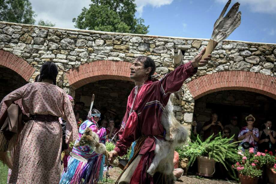 "Actor Jesse Borrego, a Native American descendant, performs as ""coyote man"" with the Texas Dance Theater at the sixth annual Four Seasons Indian Market at Mission Espada. The festival was two weeks after the missions became a World Heritage Site. Photo: Photos By Matthew Busch /For The San Antonio Express-News / © Matthew Busch"