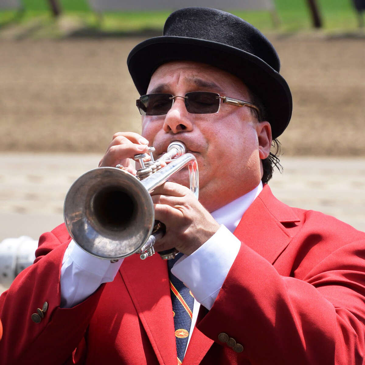 """Sam """"The Bugler"""" Grossman plays Happy Birthday before the start of the first race as Saratoga Race Course celebrates its 150 year anniversary Saturday Aug. 3, 2013, in Saratoga Springs, NY. (John Carl D'Annibale / Times Union) ORG XMIT: MER2013080317162720"""