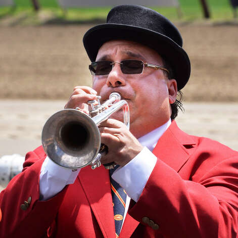 "Sam ""The Bugler"" Grossman plays Happy Birthday before the start of the first race as Saratoga Race Course celebrates its 150 year anniversary Saturday Aug. 3, 2013, in Saratoga Springs, NY.   (John Carl D'Annibale / Times Union) ORG XMIT: MER2013080317162720 Photo: John Carl D'Annibale / 10023367A"