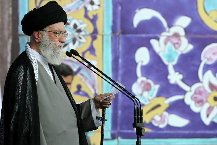 "Supreme Leader and Ayatollah Ali Khamenei delivers a sermon Saturday during the Eid al-Fitr prayer in Tehran, Iran. Khamenei said a historic nuclear deal with world powers reached this week doesn't signal an end to Iran's hostility toward the ""arrogant"" government of the United States. Photo: UNCREDITED, HOGP / Office of the Iranian Supreme Le"