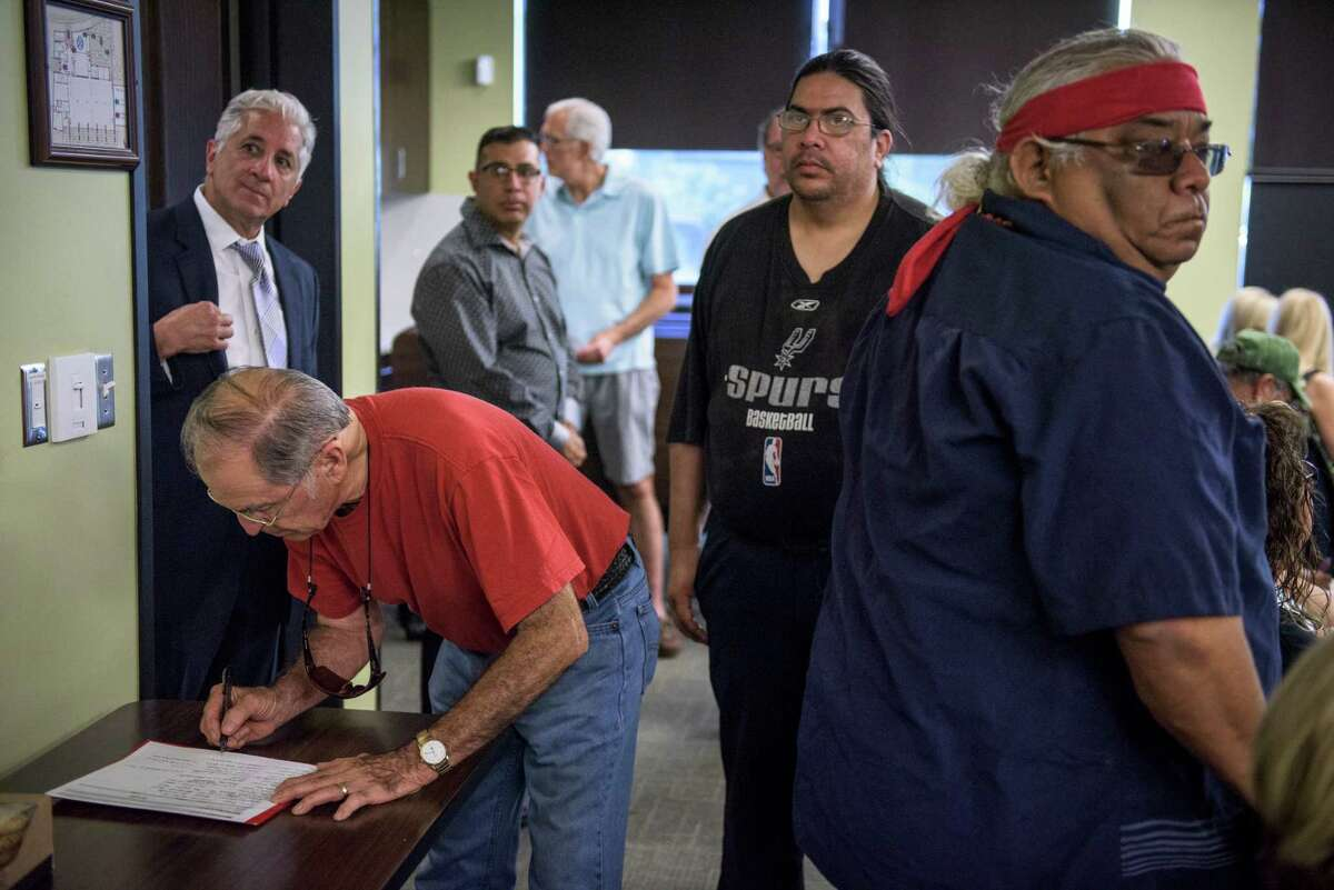 Residents sign in during a meeting between members of the Mission San Jose Neighborhood Association and San Antonio based developers 210 Development Group who want to build an apartment complex in proximity to San Jose Mission, which recently gained World Heritage Status.