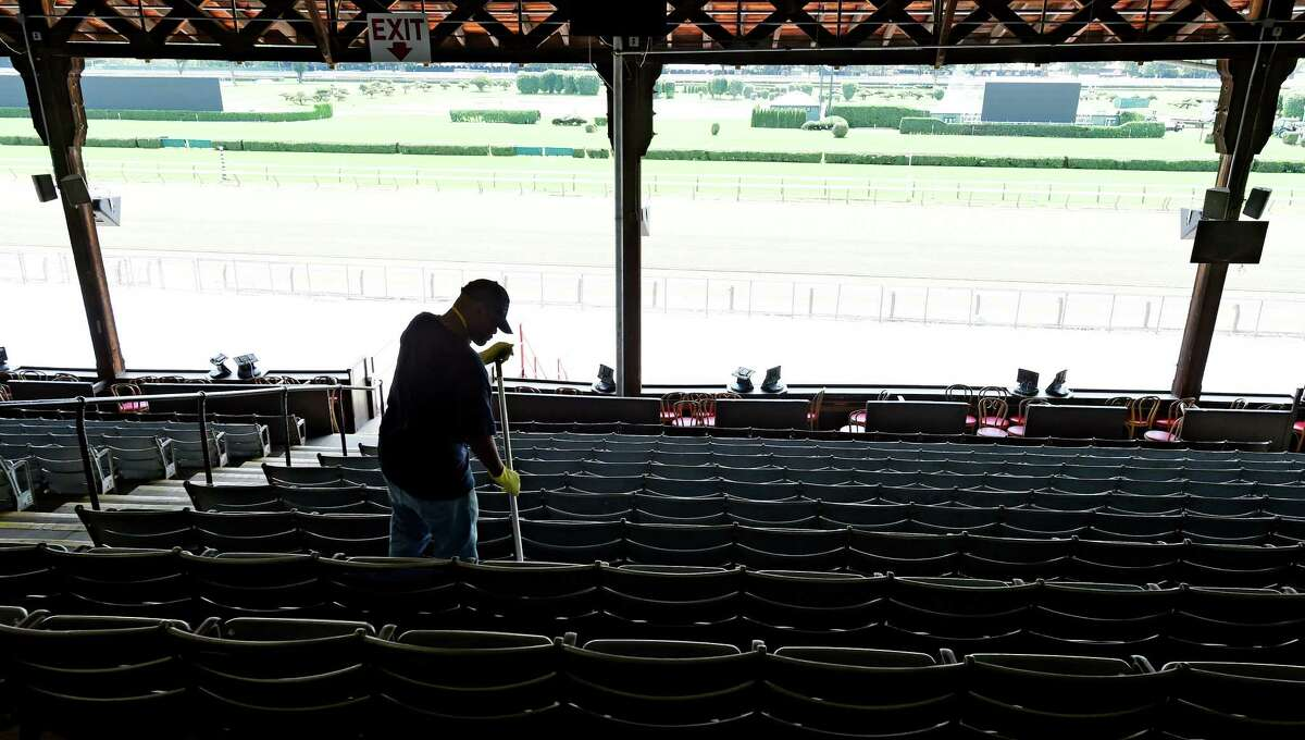 Robert Johnson of American Maintenance mops the floors of the grandstand of the Saratoga Race Course Wednesday afternoon July 15, 2015 in preparation for opening day next Friday in Saratoga Springs, N.Y. (Skip Dickstein/Times Union)