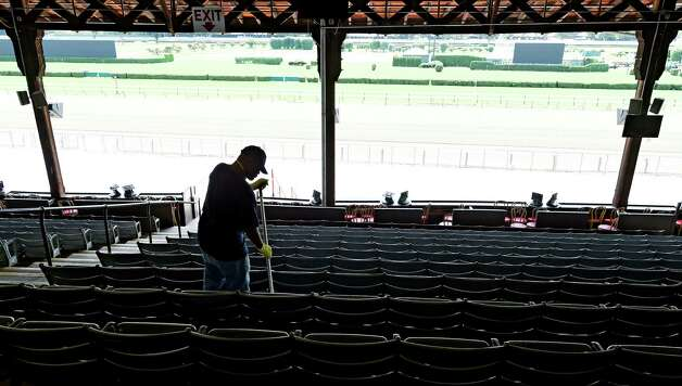 Robert Johnson of American Maintenance mops the floors of the grandstand of the Saratoga Race Course Wednesday afternoon July 15, 2015 in preparation for opening day next Friday in Saratoga Springs, N.Y.      (Skip Dickstein/Times Union) Photo: SKIP DICKSTEIN / 00032626A