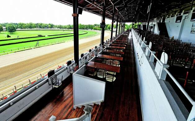 The Turf Terrace of the Saratoga Race Course Wednesday morning July 15, 2015 is ready for opening day next Friday in Saratoga Springs, N.Y.      (Skip Dickstein/Times Union) Photo: SKIP DICKSTEIN / 00032626A