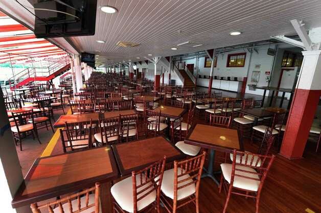 Tables and chairs are awaiting racing patrons on the first floor dining area of the Saratoga Race Course Wednesday afternoon July 15, 2015 opening day next Friday in Saratoga Springs, N.Y.      (Skip Dickstein/Times Union) Photo: SKIP DICKSTEIN / 00032626A