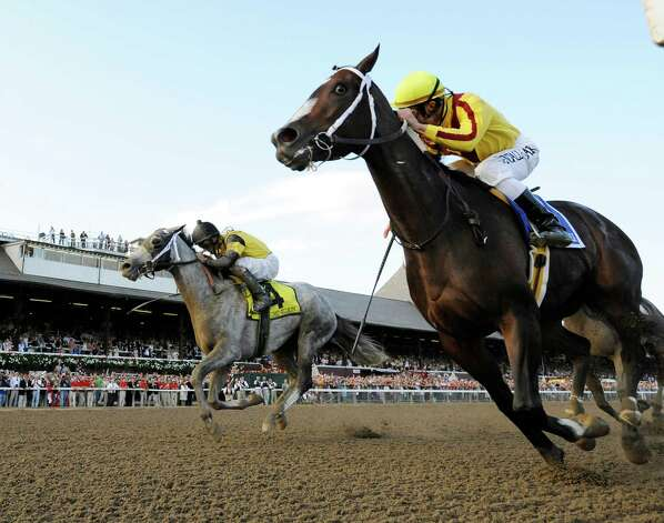 Rachel Alexandra with jockey Calvin Borel up(r) out finishes Macho Again with jockey Robby Albarado up to win the 56th running of the Woodword at the Saratoga Race Course in Saratoga Springs, New York September 5, 2009.   (Skip Dickstein / Times Union) Saratoga racing Photo: SKIP DICKSTEIN
