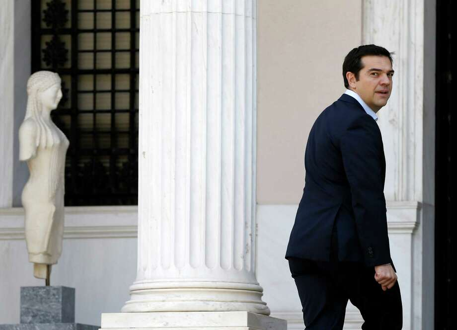 Greece's Prime Minister Alexis Tsipras  arrives at Maximos Mansion after a swearing in ceremony of his new ministers in Athens, Saturday, July 18, 2015. Tsipras reshuffled his Cabinet on Friday following a rebellion within his party over a parliamentary vote to approve the measures demanded for the bailout talks to start. Greek parliament approved creditor's demand for austerity measures. (AP Photo/Thanassis Stavrakis)   ORG XMIT: ATH102 Photo: Thanassis Stavrakis / AP
