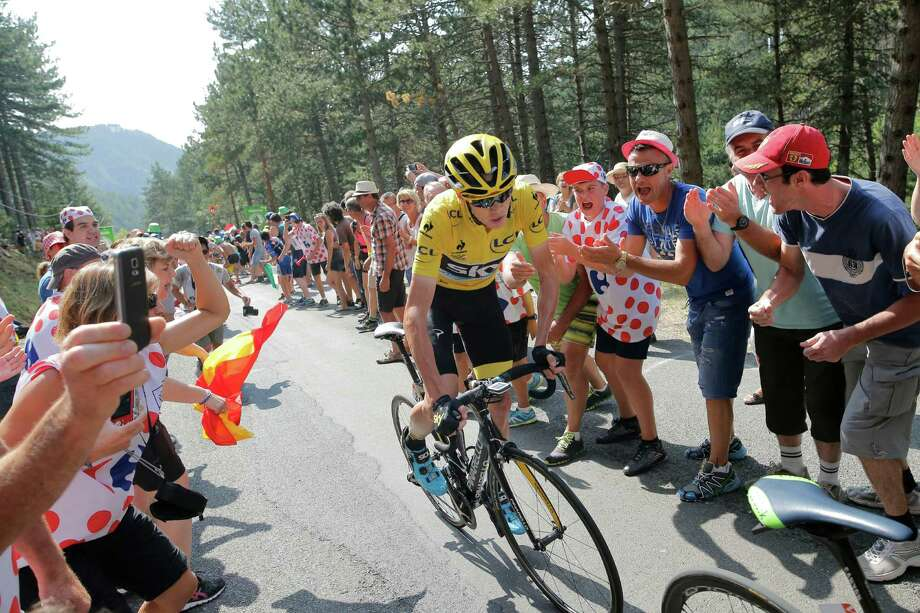 Britain's Chris Froome, wearing the overall leader's yellow jersey, blames some in the media for creating an atmosphere that he says led to him being splashed with urine by a spectator during Saturday's stage. Photo: Laurent Cipriani, STR / AP