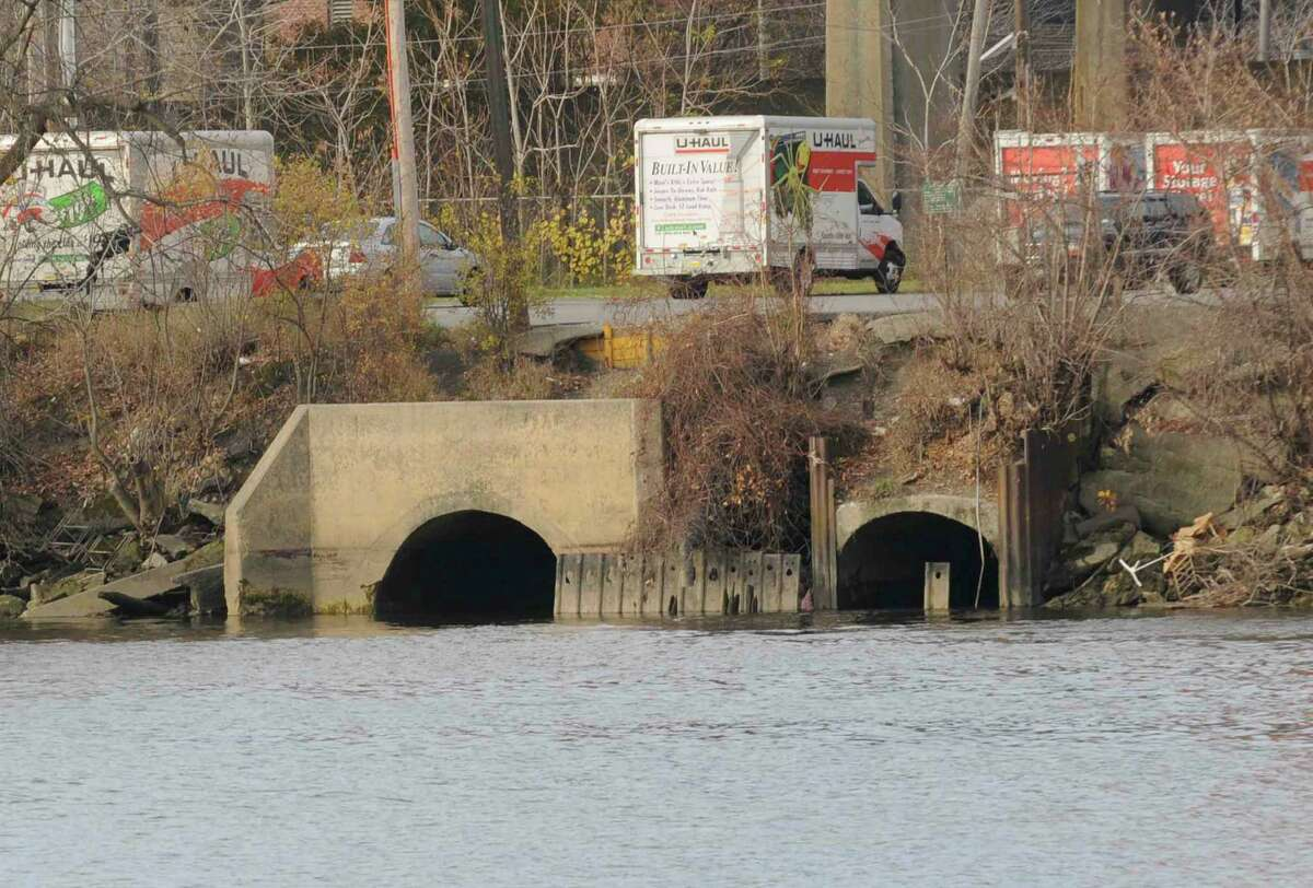 Big sewer pipe that flows into the Hudson River below the U-Haul Building in Albany,New York 11/13/2009. (Michael P. Farrell/Albany Times Union)