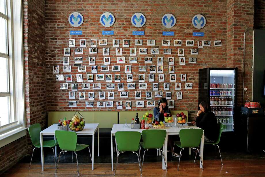 The cafeteria in the MuleSoft offices in San Francisco has one wall with photos of employees and fun facts about them. Photo: Connor Radnovich / Photos By Connor Radnovich / The Chronicle / ONLINE_YES