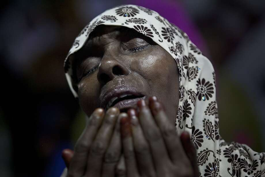 A woman cries as she prays at Baitul Mukarram, the National Mosque, on Eid Al-Fitr July 18, 2015 in Dhaka, Bangladesh. Muslims around the world are celebrating Eid Al-Fitr, which marks the end of the holy fasting month of Ramadan. Photo: Allison Joyce