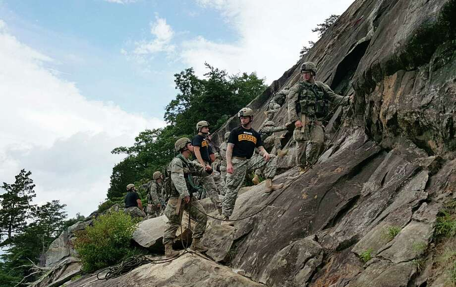 A two-person team of Ranger students, including a woman at left, receives guidance from a Ranger instructor on Mount Yonah in northern Georgia. The Army's Ranger School is assessing its first class to include female students, of whom three have advanced to the second phase. Photo: DAN LAMOTHE, STF / THE WASHINGTON POST