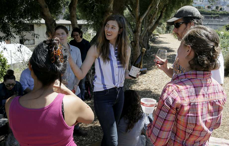 Elly Hartshorn pours wine for the volunteers that came to help out at her small vineyard at Alemany Farm in San Francisco, Calif., as seen on Sat. July 18, 2015. Elly Hartshorn started her vineyard by planting grapes in a slice of parkland above the Alemany Farmers Market, where she volunteered. Photo: Michael Macor, The Chronicle