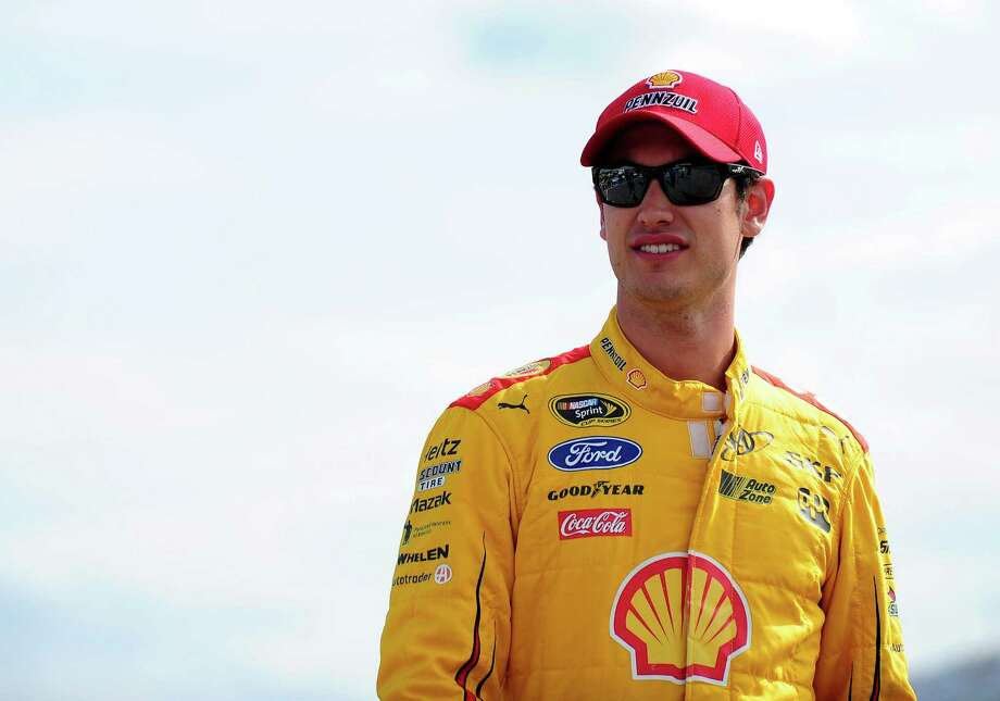 LOUDON, NH - JULY 17:  Joey Logano, driver of the #22 Shell Pennzoil Ford, stands on the grid during qualifying for the NASCAR Sprint Cup Series 5-Hour Energy 301 at New Hampshire Motor Speedway on July 17, 2015 in Loudon, New Hampshire.  (Photo by Jeff Curry/Getty Images) ORG XMIT: 532279227 Photo: Jeff Curry / 2015 Getty Images