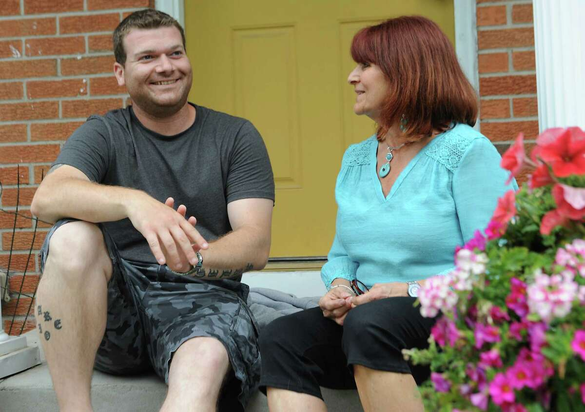 Jordan Malin sits with his mother Julianne Malin at their home on Monday, June 15, 2015, in Rotterdam, N.Y. (Lori Van Buren / Times Union)