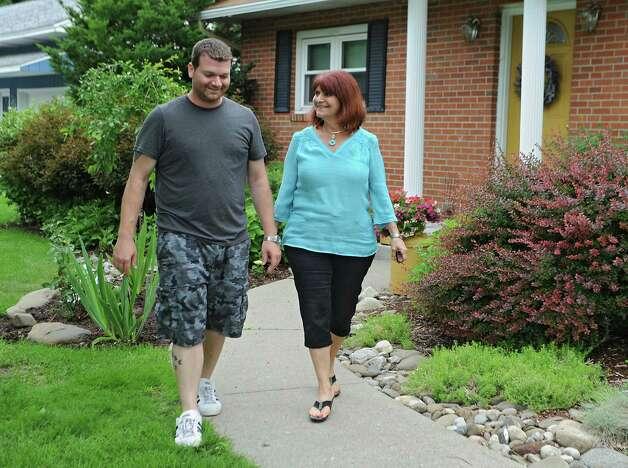Jordan Malin walks with his mother Julianne Malin in front of their home on Monday, June 15, 2015, in Rotterdam, N.Y. (Lori Van Buren / Times Union) Photo: Lori Van Buren / 00032280A