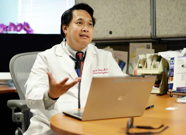 "Dr. Jose ""Jun"" David in his office at Prime Care Physicians Friday June 19, 2015 in Albany, NY.  (John Carl D'Annibale / Times Union) Photo: John Carl D'Annibale / 00032331A"