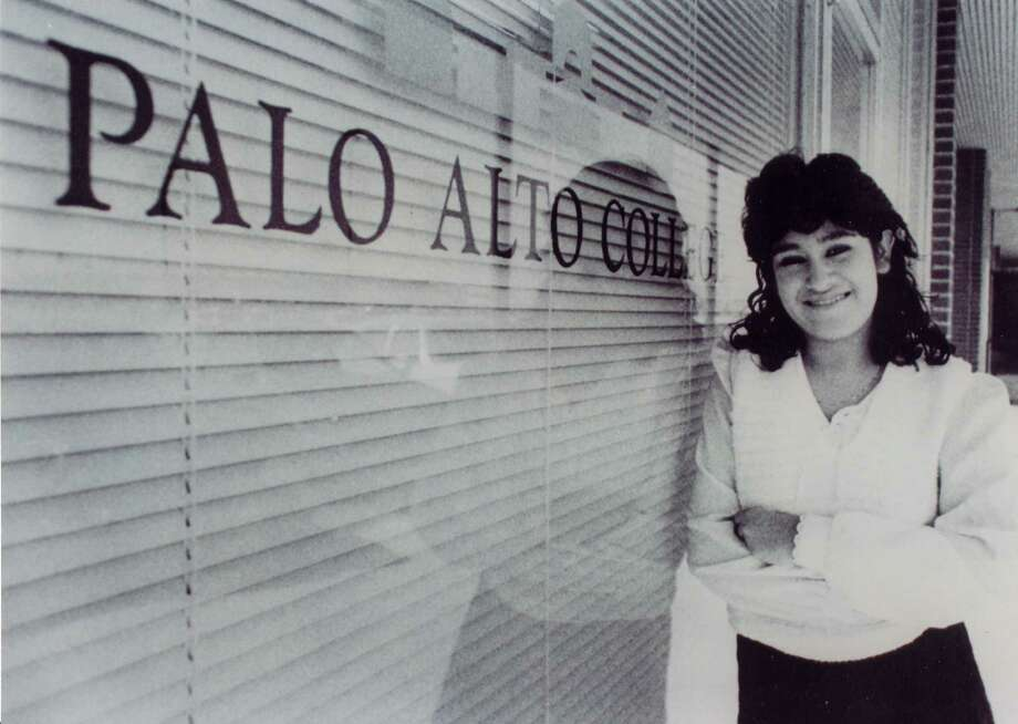 Elizabeth Aguilar-Villarreal, Palo Alto College's first enrolled student, poses outside the College's original administration office. Aguilar-Villarreal now serves as director of enrollment at Palo Alto College. Photo: Courtesy Palo Alto College