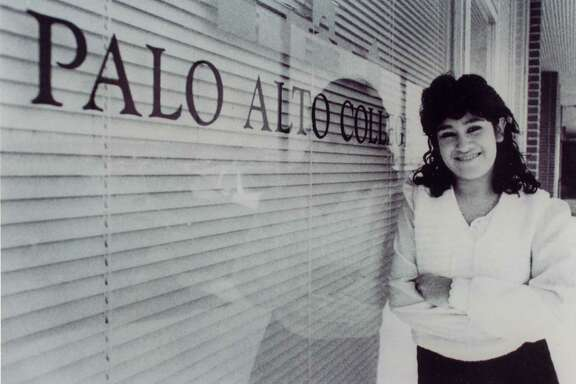 Elizabeth Aguilar-Villarreal, Palo Alto College's first enrolled student, poses outside the College's original administration office. Aguilar-Villarreal now serves as director of enrollment at Palo Alto College.