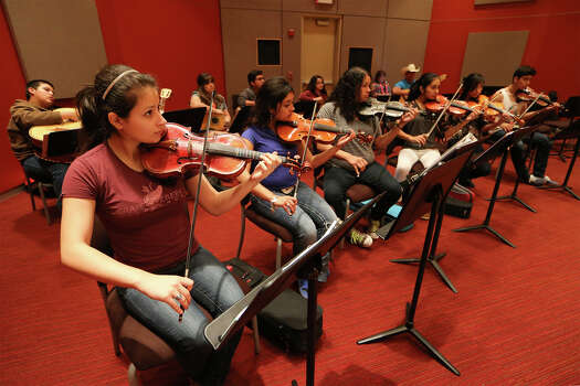 Graciela Gomez (front row from left), Ashley Reyes, Cynthia Torres, Paulina Aguilar, Isabella Lara and Kairo Valdez play violins at the front of the class during a classroom session of the Juan Ortiz Mariachi Academy at Palo Alto College on May 6, 2015. Photo: Marvin Pfeiffer /San Antonio Express-News / Express-News 2015