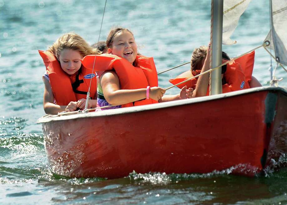 Katherine Donato, 8, left, of New Fairfield, and Skye Parsell, 9, of Bethel, go for a sail at the Candlewood Day Camp. Sailing lessons are among the activities for members of the Girls Scouts. Photo: Carol Kaliff / Hearst Connecticut Media / The News-Times