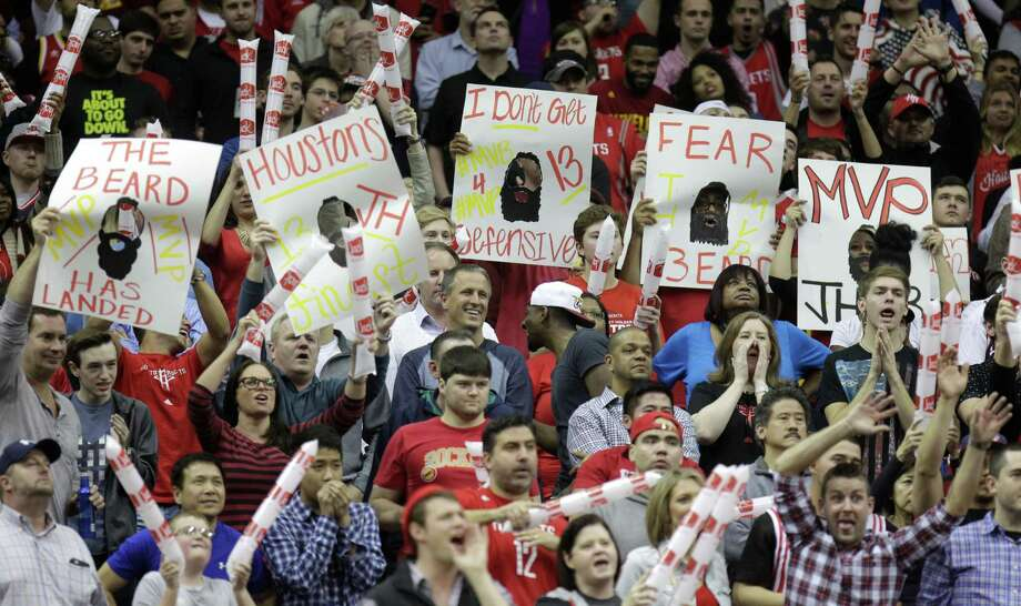 Move over ZZ Top, there's a new beard in town. Rockets fans attest to James Harden's popularity. Photo: Melissa Phillip, Staff / © 2014  Houston Chronicle