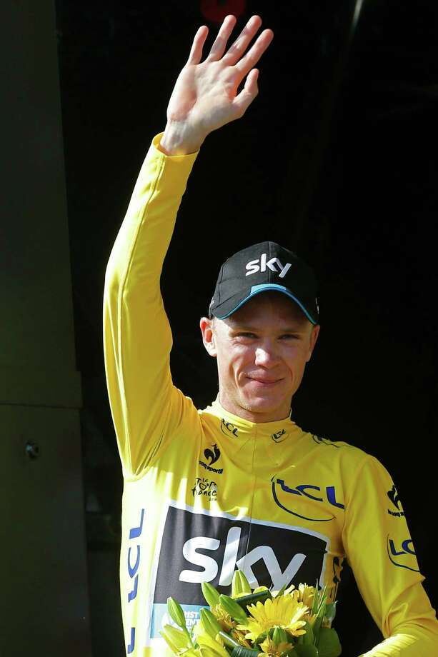 Britain's Chris Froome, wearing the overall leader's yellow jersey, celebrates on the podium of the fourteenth stage of the Tour de France cycling race over 178.5 kilometers (110.9 miles) with start in Rodez and finish in Mende, France, Saturday, July 18, 2015. (AP Photo/Christophe Ena) ORG XMIT: PDJ138 Photo: Christophe Ena / AP