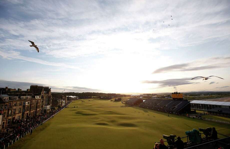 Despite the erratic weather this weekend, it's always a scenic view down the 18th fairway at the Old Course in St. Andrews, Scotland. For the first time since 1988, the British Open will be played on a Monday. Photo: Alastair Grant, STF / AP
