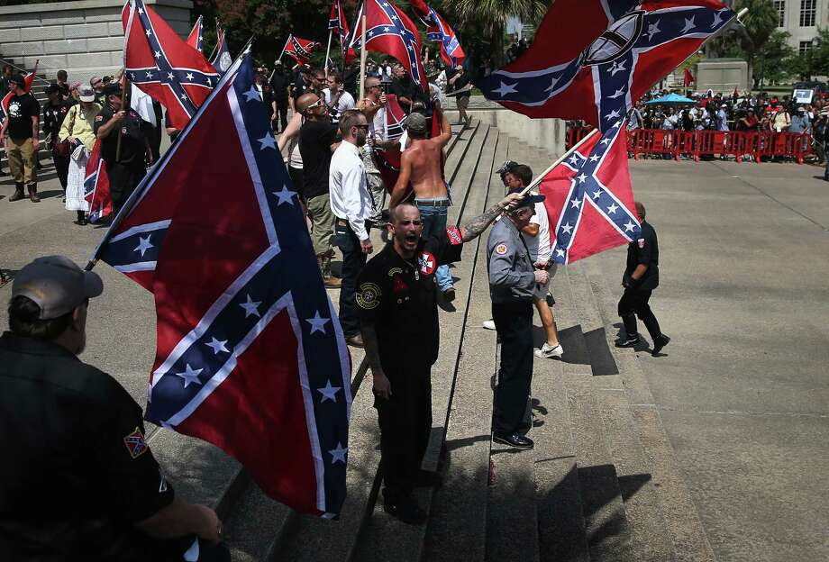 Members of the Ku Klux Klan protested last year at the state house building in Columbia, South Carolina over the removal of the Confederate Flag from state grounds. Photo: John Moore, Getty Images / 2015 Getty Images