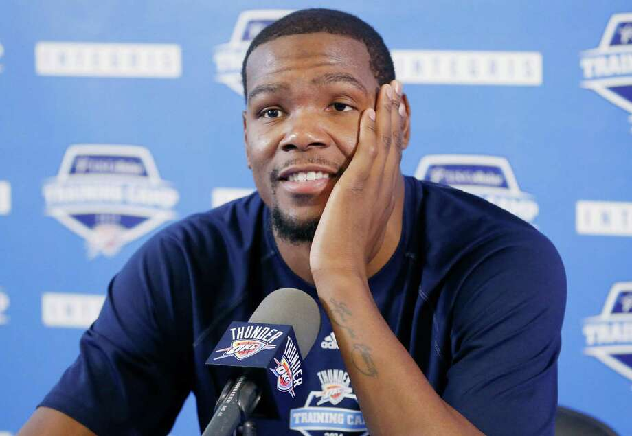 It's anybody's guess as to where the Thunder's Kevin Durant ends up once the free-agency dust settles next summer. But he's certain to see dollar signs. Photo: Sue Ogrocki, STF / AP
