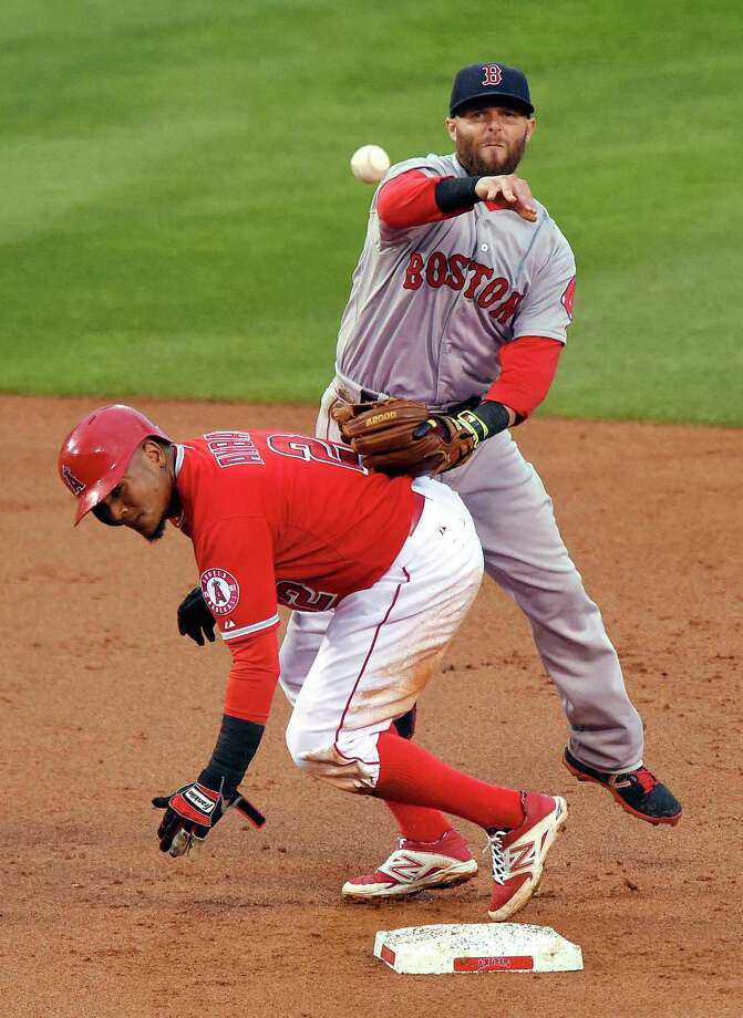 Los Angeles Angels' Erick Aybar, below, is forced out at second as Boston Red Sox second baseman Dustin Pedroia attempts to throw out David Freese at first during the second inning of a baseball game, Saturday, July 18, 2015, in Anaheim, Calif. Freese was safe at first on the play. (AP Photo/Mark J. Terrill) ORG XMIT: ANS102 Photo: Mark J. Terrill / AP