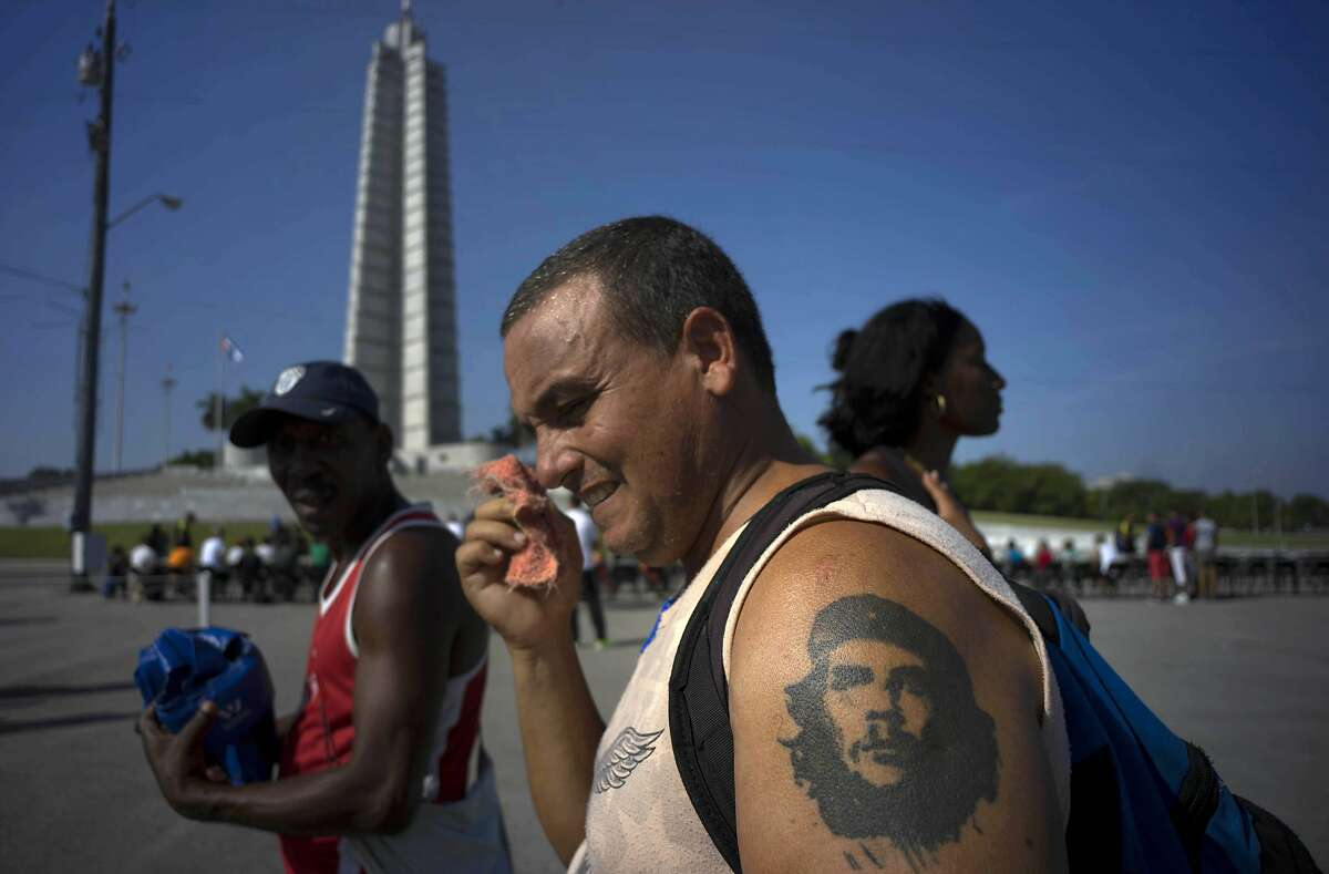 A man with his arm tattooed with Cuban revolutionary hero Ernesto