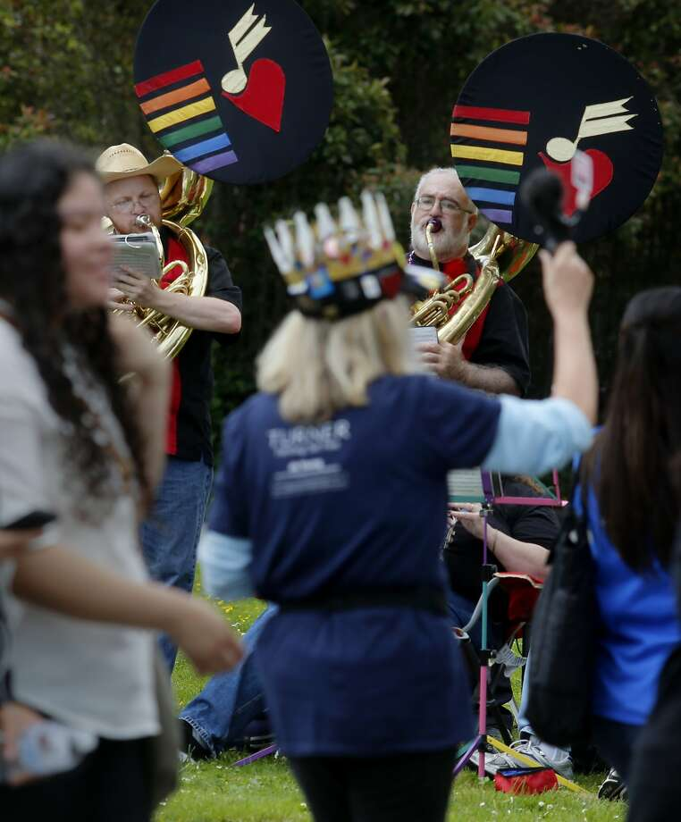 Members of the San Francisco Lesbian/Gay Freedom Band serenaded the walkers Sunday July 19, 2015. Thousands of people walked over six miles to raise money during the annual AIDS Walk San Francisco event held in Golden Gate Park. AIDS Walk San Francisco is the largest AIDS fundraising event in Northern California. Photo: Brant Ward, The Chronicle