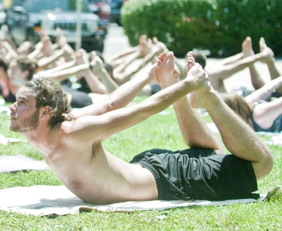Matt Dickens of Danbury participates in a 90 minute yoga class instructed by Bikram Yoga Danbury. Free yoga, massages and facial consultations on the Danbury Green at Ives Street as part of The Greater Danbury Health and Wellness Fair. Sunday, July 19, 2015